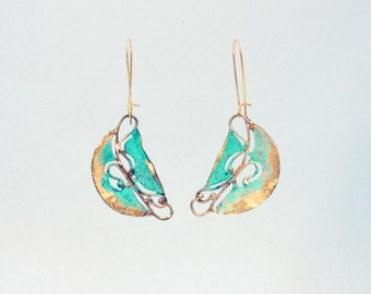 Modern, avant garde earrings with unique shape and patina finish