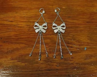 Eighties Bow Earrings (A cute set of silver tone and rhinestone bow and tassel dangle earrings.)