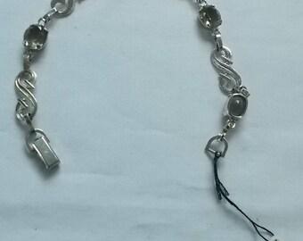 Sterling Silver Bracelet with Four Smokey Rhinestones.  (601)