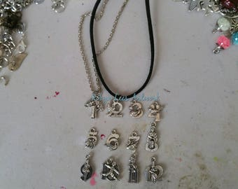 Small Silver 12 Days of Christmas Set of 12 Necklaces 1 to 12 Numbers with Illustration Charms on Silver Chain or Black Faux Suede Cord