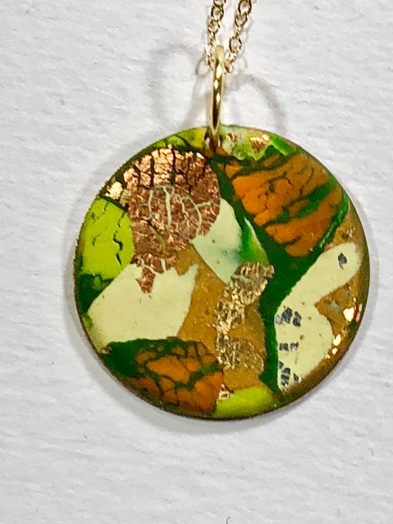 Handmade orange/green/yellow/gold/copper polymer clay round pendant necklace with abstract asymmetric design