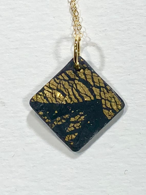 Handmade black/gold polymer clay diamond shape pendant necklace with abstract asymmetric design