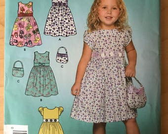 Simplicity 3857 - Easy to sew Little Girl's Summer Dress with Sleeveless or Short Puff Sleeve Option and Matching Purse - Size 3 4 5 6 7 8