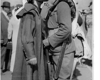 Antique photo of soldier leaving for war.  Kissing his girl.   1923