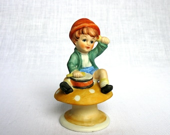 Boy With A Drum / Little Drummer / Boy Sitting On A Mushroom / Hand Painted / Bisque / Porcelain Figurine / Marked Foreign / Mid Century