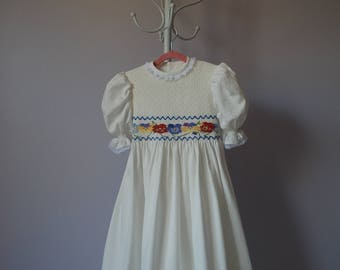 "Hand smocked winter white twill dress ""Spring Pansies"""