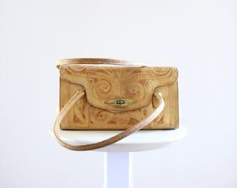 1940's worn + tooled leather handbag