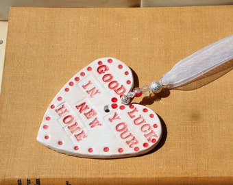 Good Luck in your New Home Handmade Pottery Heart, hand painted with red and white glazes. Sent in a lovely gossamer bag to give as a gift.