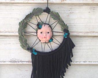 Babydoll head black blue flowers laurel wreath vegan friendly yarn dreamcatcher wall art tapestry mobile hanging