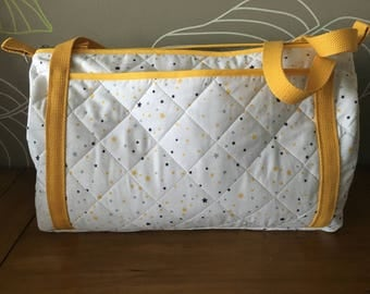 Quilted fabric diaper bag.