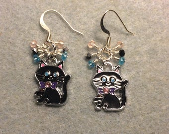 Black, turquoise, and pink enamel cat charm earrings adorned with tiny dangling black, turquoise, and pink Chinese crystal beads.