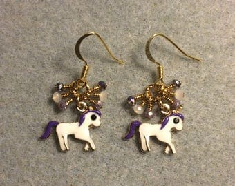 Small white and purple enamel unicorn charm earrings adorned with tiny dangling white and purple Chinese crystal beads.