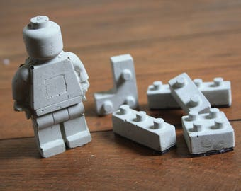 Magnets of concrete and maxi Lego figure