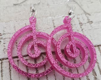 Hypnotic Pink Spiral Earrings in glamorous glittery finish