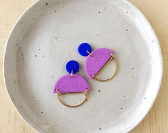 Silhouette Earrings - Blue & Violet with a Brass Semi Circle Silhouette.