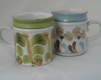 Denby pottery mugs. A pair of 1970s mugs by Denby pottery of Derbyshire. Designed by Trish Seal. Coffee mugs