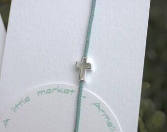 Sterling Silver Cross and celadon adjustable cord bracelet