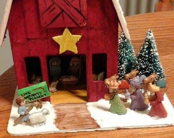 Miniature nativity pageant in a barn, complete with Mary, Joseph, baby Jesus, shepherds, kings, camels, angel, sheep, and a donkey