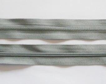 Zipper zips grey