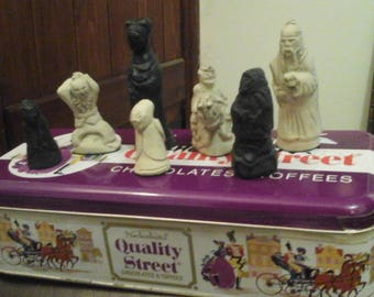 Carved oriental chess pieces