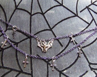 Gothic cross and bat nose to ear chain