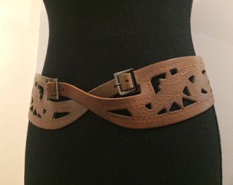 Tan leather belt with embossed decorative patterns