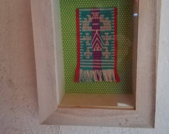 Framed hand-made woven wall hanging