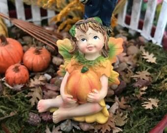 Miniature Little Girl Fall Fairy with a Pumpkin