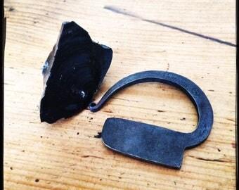 Steel fire striker and obsidian