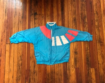 W medium. Ugly 80s windbreaker suit. ugly skii jacket and pants . Track and field. Marathon running. Hot tub time machine. Ugly runner Hideo