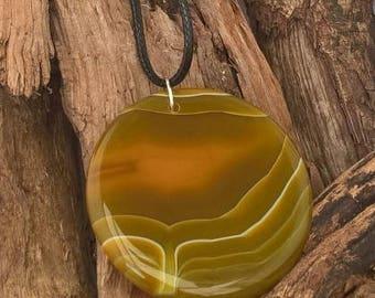 Carnelian Sunset Pendant on leather cord.
