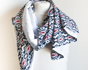 Blue and white scarf with ethnic motifs