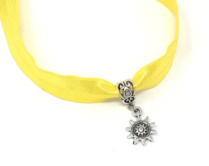 LOST SUN CHOKER: sun charm on yellow elastic choker