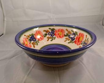 A Beautiful Handmade Ceramic Pottery Bowl painted with flowers.