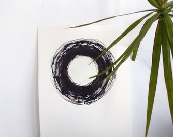 Zen circle with black ink on cotton paper
