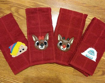 Rudolph the red nosed reindeer kitchen dish or hand towel. Seasonal decoration. In red or white towel