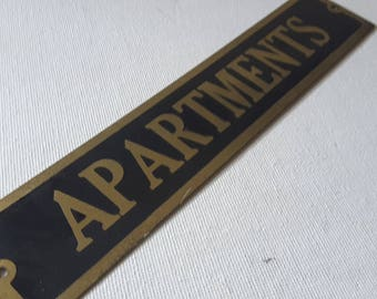 Brass sign, APARTMENTS