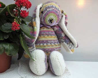 Annabelle Rainbow Rabbit in strippy yarn, hand knitted soft toy.