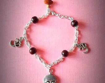 Bangle, charms Bouddha, OHM, wood and seed's pearls. Zen, spiritual