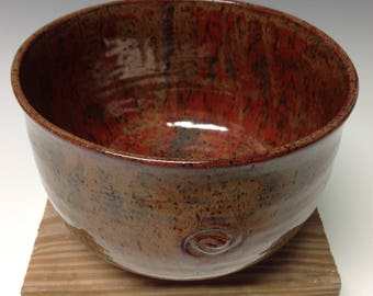 Frosty-red speckled serving bowl