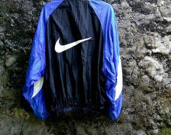 Vintage 90s NIKE Swoosh Big Logo Multicolor Windbraker Jacket. Size Medium US