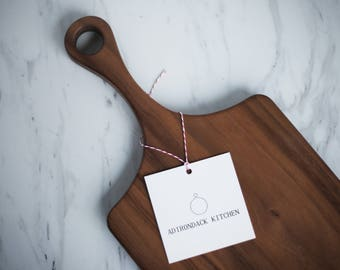 Classic Walnut Wood Cutting Board with Handle, Wood Serving Board, Paddle Board - FREE CARE KIT