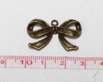 Bronze bow pendant