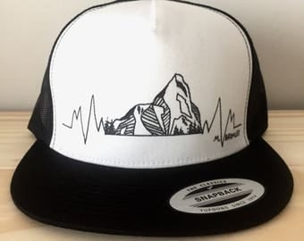 My heart beats for the mountains Trucker Hat