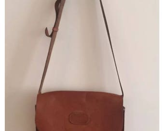 Saddle LeatherTan Body Bag with adjustable strap. Bag is made of very sturdy leather