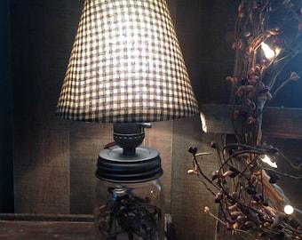 Primitive mason jar lamp.