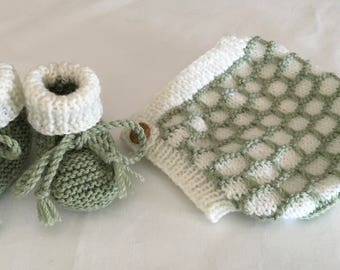 Hand knitted cream and pale eucalyptus pixie hat and matching booties.
