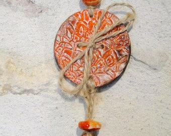 "Suspension ""orange button"" out of ceramics, raku, hand-made"