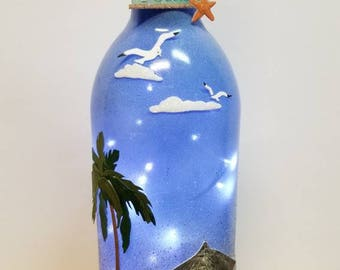 Paradise lighted wine bottle