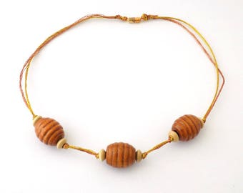Necklace wood beads metalized golden copper yarns